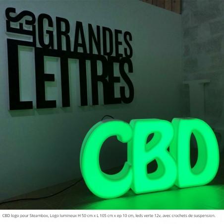 CBD abréviation de  cannabidiol, magasin de cigarettes électroniques Steambox. logo lumineux, leds verte